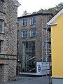 Radevormwald-Dahlerau, Textilstadt Wülfing, Verwaltungsgebäude, SW-Ecke, gläsernes Treppenhaus.jpg
