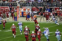 Reagan Mauia rushes in Christmas game 2010.jpg