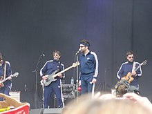 Eels onstage, wearing track suits