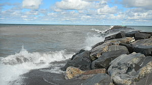 Keweenaw Waterway - The rock jetty at the north entrance separating Lake Superior on the left from the calmer waters of the Waterway on the right
