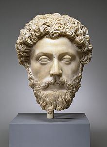 Marble bust of Marcus Aurelius. This masterful portrait captures the pensive temperament of the philosopher-emperor and author of the celebrated 'Meditations', reflections on life and the ways of the gods. The smooth, softly modeled carving of the flesh contrasts markedly with the mass of thick, curling hair. The drooping eyelids and detached gaze suggest his contemplative nature.