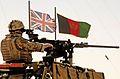 Royal Marine Mobile Patrol Passes Afghan and British Flags MOD 45151881.jpg