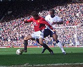 ed2504a07 Van Nistelrooy (left) playing for Manchester United versus Tottenham  Hotspur in 2004