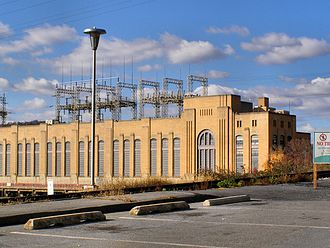 Amtrak's 25 Hz traction power system - The Safe Harbor Dam generates 25 Hz railroad power via two turbines in the east end of the turbine hall and an M-G set outside against the Dam face.