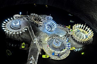 Salina Turda - Salina Turda – view of the underground lake and UFO-shaped constructions