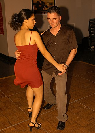 Partner dance - Two people doing the Salsa.