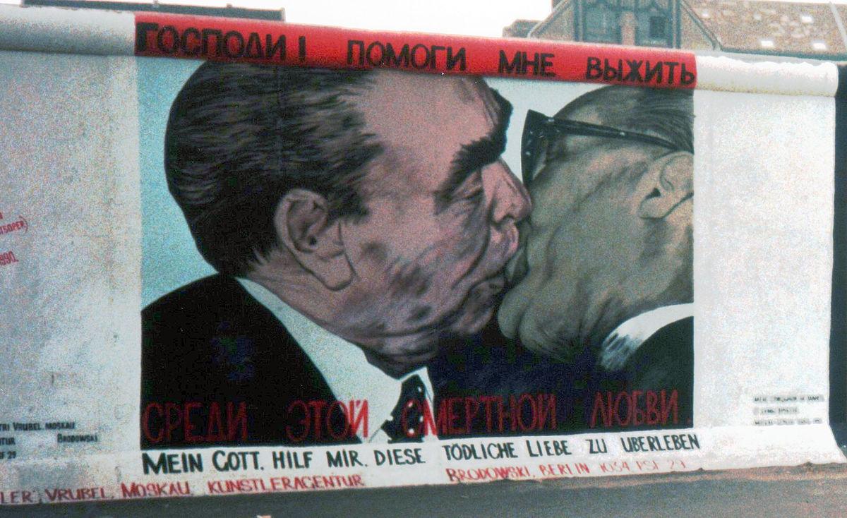 Woman dating berlin wall