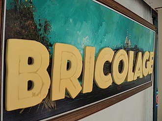 Bricolage - A self-referential sign built using bricolage techniques on a thrift store painting