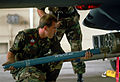 Sgt. Brian Boe loads a 2.75-inch rocket with a practice warhead into an M-260 rocket pod mounted on an OV-10 Bronco aircraft during the Pacific Air Forces (PACAF) combat ammunition production and combat aircraft DF-ST-91-07824.jpg