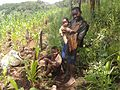 Shamba boys caring child-Tanzania.jpg