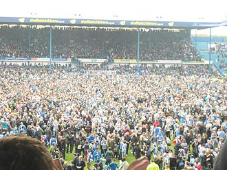 2011–12 Sheffield Wednesday F.C. season - Wednedayites celebrating on the pitch, following promotion to the Championship, on 5 May 2012