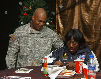 Sheryl Underwood - Sheryl Underwood with a soldier at Camp Arifjan, Kuwait, December 12, 2007 as a part of the Sgt. Maj. of the Army's Hope and Freedom tour to entertain deployed troops.