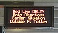 Sign indicating Red Line delays.jpg