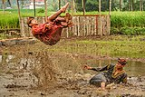 Silek Lanyah 2020 - Two men performing martial art in a stream.jpg