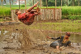 Silek Lanyah 2020 - Two men performing martial art in a stream.jpg