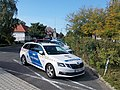 Skoda police car and Country Flag memorial, 2018 Balatonlelle.jpg