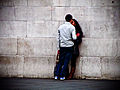 Smooching by a Wall (5801007124).jpg