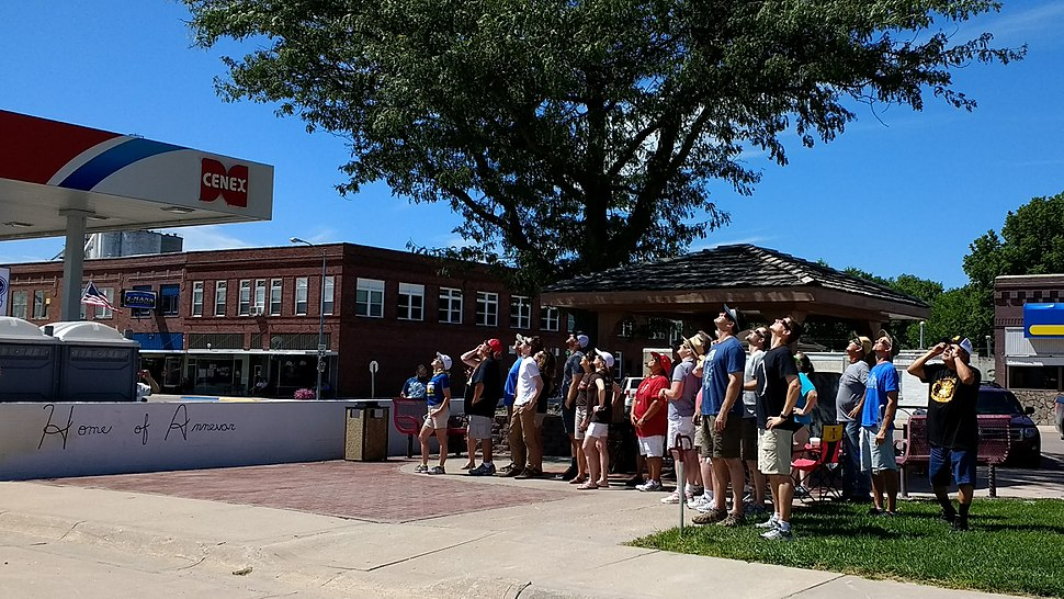 Visitors and residents gather to observe the eclipse in Ravenna, Nebraska.