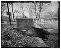 South abutment, looking northwest. - Pendleton Avenue Bridge, Spanning Fall Creek, Pendleton, Madison County, IN HAER IND,48-PEN,1-10.tif
