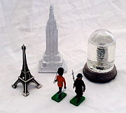 Souvenirs from around the world. Clockwise from top, Empire State Building, New York City, New York, USA; Leaning Tower of Pisa, Pisa, Italy; Queen's Guards, London, United Kingdom; Eiffel Tower, Paris, France.