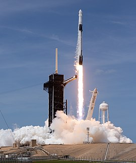 Ground-level view of a Falcon 9 lifting off from its launch pad