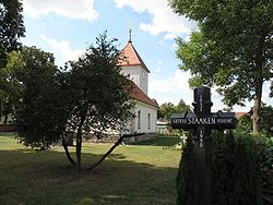 Village church with commemoration cross to Staaken's division from 1951 to 1990