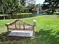 Starr-160716-0137-Stenotaphrum secundatum-with Ibis on bench around water feature-Boca Regional Hospital-Florida (29586637801).jpg