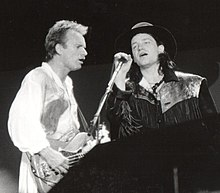 Sting and Bono performing.