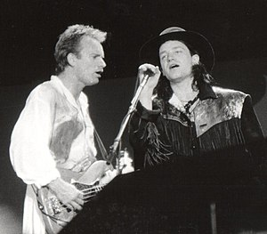 The Joshua Tree - Sting and Bono performing during A Conspiracy of Hope in June 1986. U2's appearance on the tour helped them focus their new material being written for The Joshua Tree.