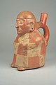 Stirrup Spout Bottle with Seated Figure MET 64.228.34.jpeg