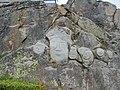 Stone and man carved in rock Qarqortoq Greenland.jpg