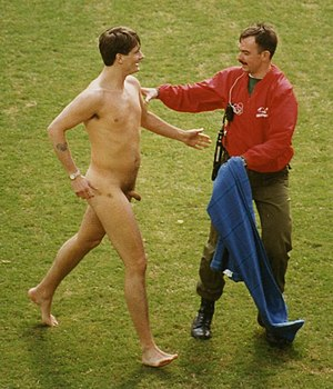 Exhibitionism - Mark Roberts, a well-known streaker, at the Hong Kong Sevens Rugby tournament in 1994.