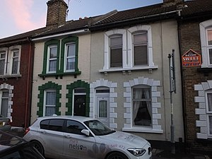 Byelaw terraced house - Decorated openings in cast stone, in style of a Gibbs surround, Strood