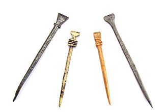 Stylus - Four examples of medieval styluses for writing on wax tablets. Two are made of iron, one brass and one bone stylus.