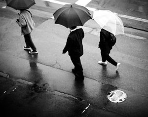 The people walk in the rain somewhere in Nagano.