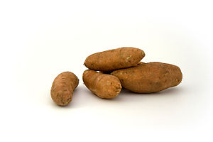 An image of a sweet potato on a white backgrou...