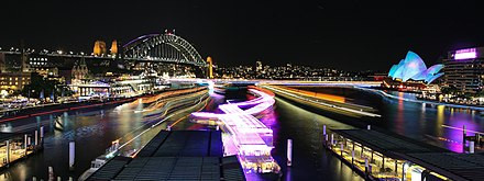 The Sydney Harbour Bridge and Sydney Opera House illuminated during the 2015 Vivid Sydney festival of light Sydney Harbour during Vivid Sydney 2015.jpg
