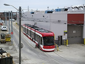 Hillcrest Complex - Flexity Outlook 4401 streetcar beside the Harvey Shops
