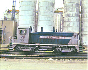 Albany Port Railroad - An EMD SW9 switcher stands in front of the Cargill Silos at the Port of Albany-Rensselaer.