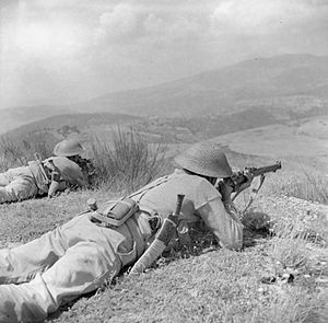 4th Infantry Division (India) - Gurkhas of the 4th Indian Division keep watch on enemy positions in Alpi di Catenaia from high ground on Monte Castiglione, 29 July 1944.
