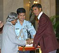 The President Dr. A.P.J. Abdul Kalam presenting the Arjuna Award for the year 2004 to the differently abled sports person Shri Devendra for Athletics, at a glittering function in New Delhi on August 29, 2005.jpg