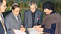 The Union Minister of Petroleum & Natural Gas Shri Murli Deora with the Leader of the Great Al Fateh Revolution, Col Muammar Gaddafi after handing over the Prime Minister's letter, at Sirte (Libya) on February 01, 2007.jpg