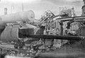 The breech of after port side four-inch gun on HMS 'Aurora (1913) while in drydock. RMG N22868.jpg