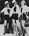 Three ladies costumed in Broadway attire in New Orleans Louisiana in the 1930s.jpg