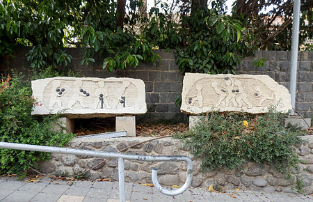 Figurines holding Tiberian vowel diacritics. Limestone and basalt artwork at the shore in Tiberias. Tiberian-vocalisation-david-fine.jpg