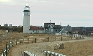 Truro, Massachusetts - Highland Light. The original site is marked by a boulder in the foreground.