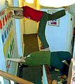 Twister two players above stairway and one stepping on other.jpg