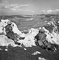 Two British soldiers on a hilltop keep watch on the enemy-occupied town of Mateur, Tunisia, 2 January 1943. NA383.jpg