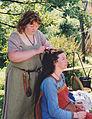 Two costumed viking females hairdressing.jpg
