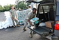 U.S. Air Force Senior Airman Randy Bullock, an air traffic controller with the 259th Air Traffic Control Squadron, Louisiana National Guard (LANG), loads a case of water into the back of a vehicle for a resident 120901-A-SM895-027.jpg
